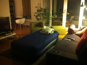 ma bed in his spotless living room