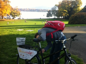 taking advantage of Geneva's free bike rentals on a rare sunny day by the lake